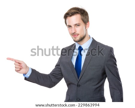 Businessman with finger point up - stock photo