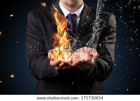 Businessman with fire and water in hands. Concept of threats and solutions as so as manager responsibility and power - stock photo