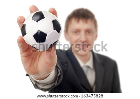 Businessman with football isolated on white. - stock photo