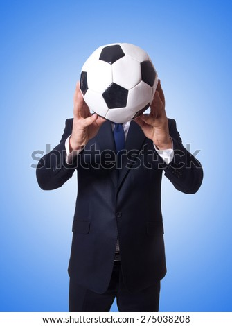 Businessman with football on white - stock photo