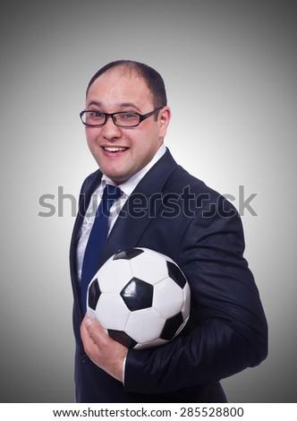 Businessman with football on white - stock photo