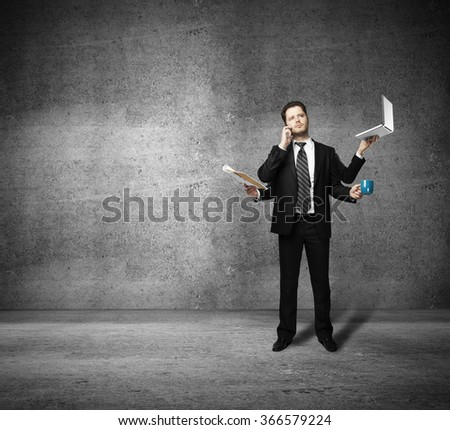 businessman with four hands holding business object - stock photo