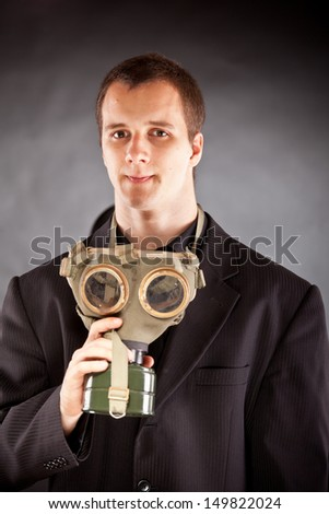 businessman with gas mask in studio - stock photo