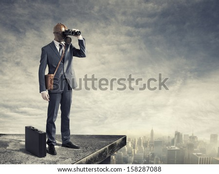 Businessman with gas mask looking through binoculars with a polluted city as background - stock photo