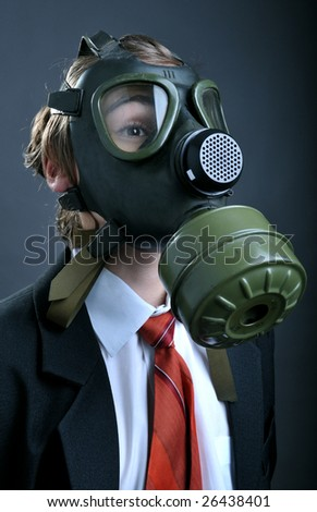 Businessman with gas mask on face - stock photo