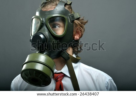 Businessman with gas mask on face