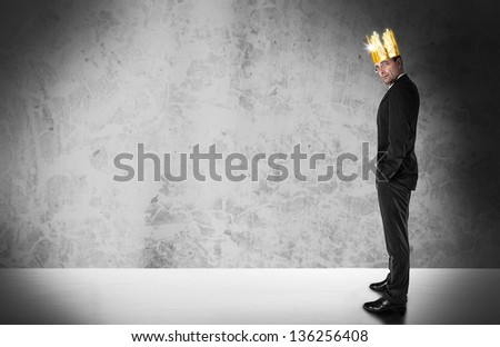 Businessman with golden crown - stock photo
