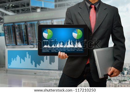 Businessman with graph report for exchange rate