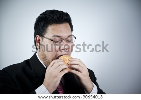 Businessman with hamburger