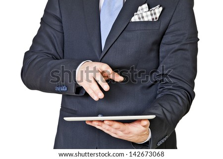 businessman with hand on tablet isolated on a white background - stock photo