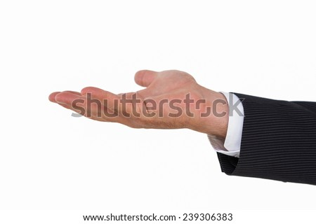 Businessman with hand out on white background