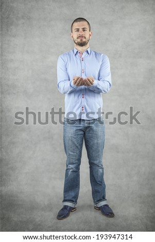 businessman with hand outstretched forward - stock photo