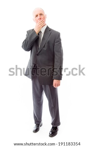 Businessman with hand over his mouth - stock photo