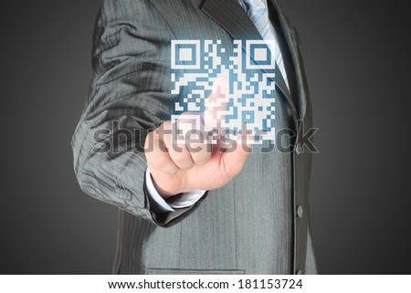 Businessman with hand pressing virtual qr code button - stock photo