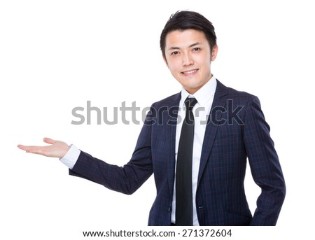 Businessman with hand showing something - stock photo