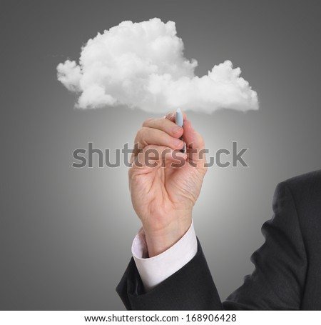 Businessman with hand touching a cloud. Cloud network concept