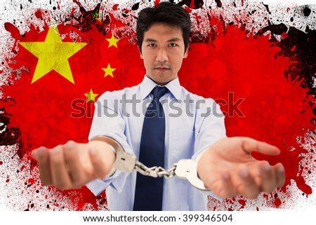 Businessman with handcuffs against china - stock photo