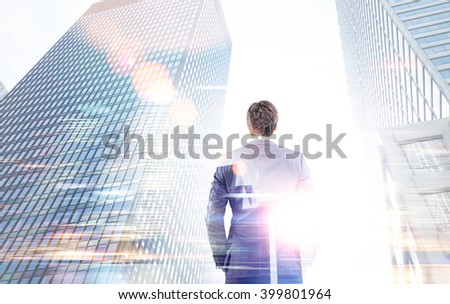 Businessman with hands in pockets between two skyscrapers. Double exposure. Concept of work. - stock photo