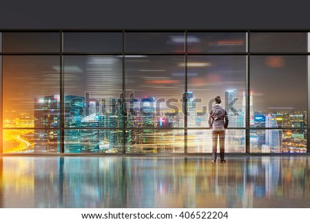 Businessman with hands in pockets standing at panoramic window. Office, night. New York view. Double exposure. Concept of thinking.
