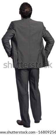 Businessman with hands on hips on white background