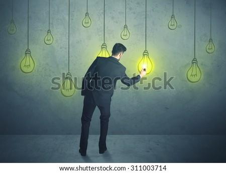 businessman with hanging lighting bulbs - stock photo