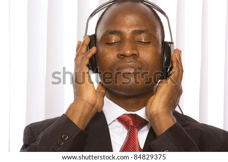 Businessman with headphones in office surroundings. Isolated - stock photo