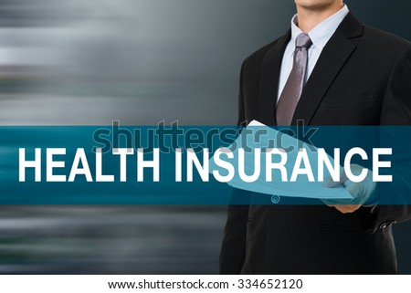 Businessman with HEALTH INSURANCE WORD - stock photo