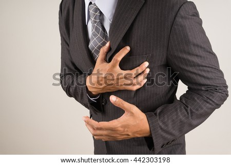 businessman with Heart Attack - stock photo