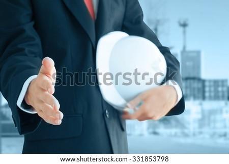 Businessman with helmet - stock photo