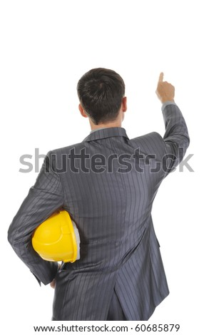 Businessman with helmet points finger up. Isolated on white background - stock photo