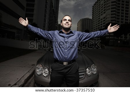 Businessman with his arms extended