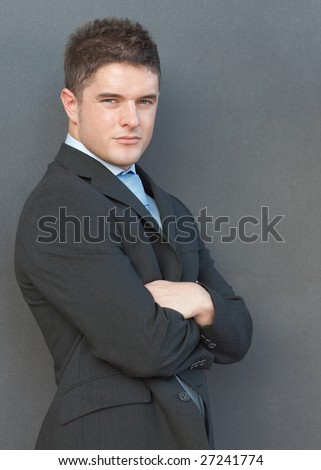 Businessman with his arms folded - stock photo