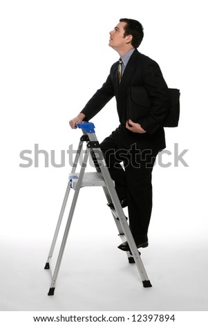 Businessman with his briefcase clutched under one arm climbing  up a stepladder with his gaze focused on the ceiling. Isolated against a white background