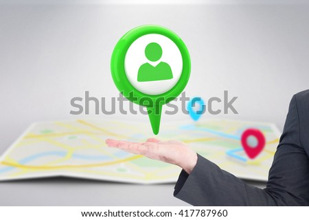Businessman with his hand out against green application symbol - stock photo