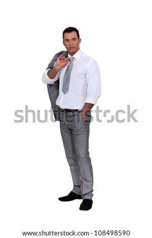 Businessman with his jacket over his shoulder - stock photo