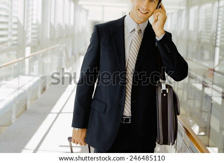 Businessman with his luggage - stock photo