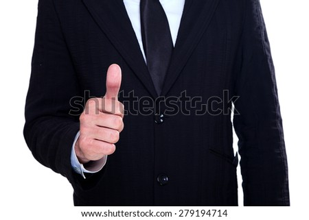 Businessman with his thumb up - stock photo