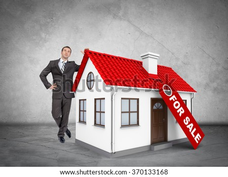 Businessman with house for sale