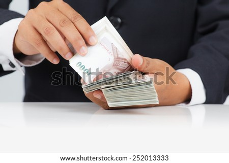 Businessman with huge amount of money