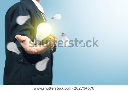 Businessman with illuminated light bulb concept for idea, innovation and inspiration - stock photo