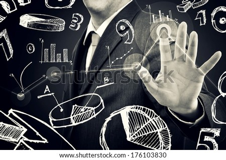 Businessman with infographics pressing touch screen button. Modern technology concept.