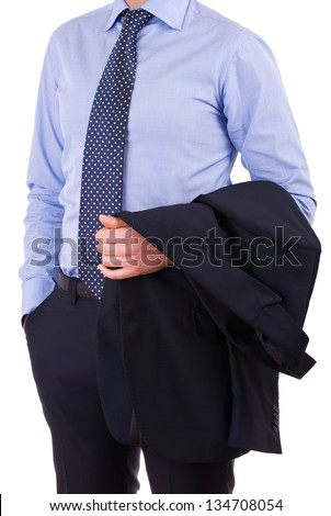 Businessman with jacket over arm. - stock photo