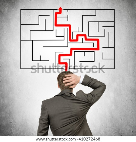 Businessman with labyrinth out his head