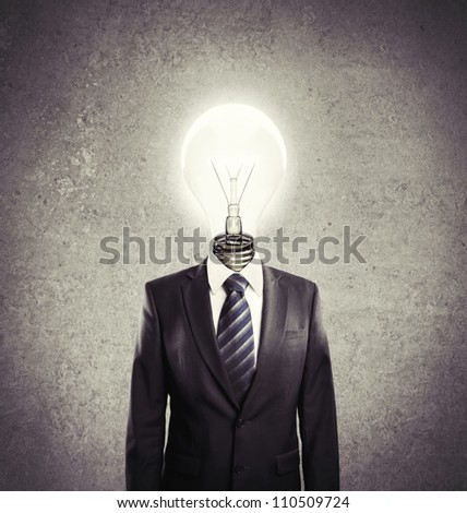businessman with lamp-head on a white background