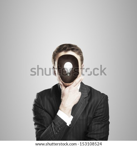 businessman with lamp in head