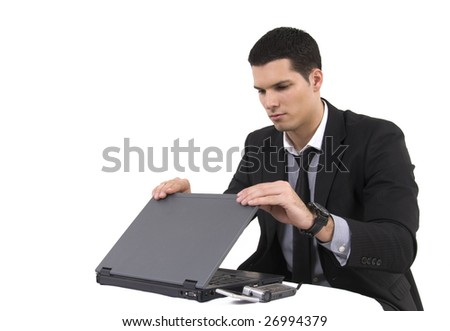Businessman with lap top computer and phone isolated on white background