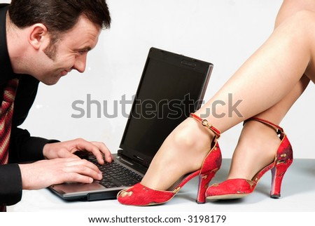 Businessman with laptop close to beautiful wonan's legs