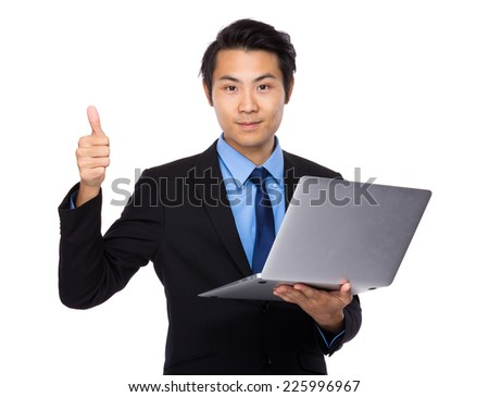 Businessman with laptop computer and thumb up