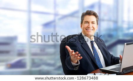 Businessman with laptop computer. Over abstract background.