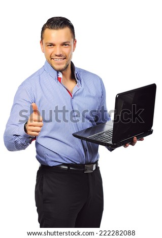 Businessman with laptop computer showing thumbs up. Isolated - stock photo